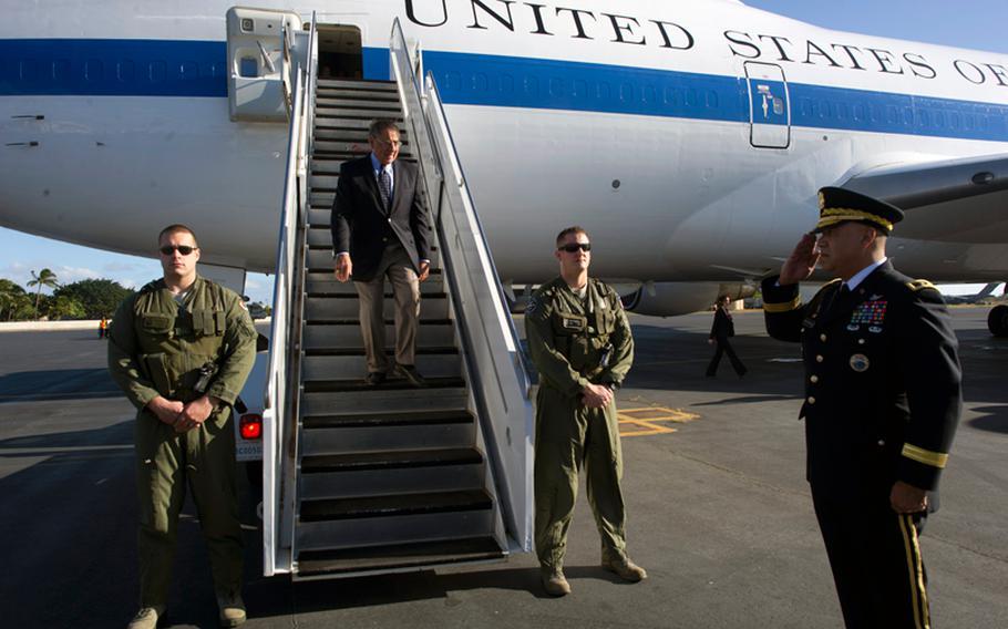Defense Secretary Leon Panetta steps off his plane as it lands in Honolulu on Nov. 11, 2012.
