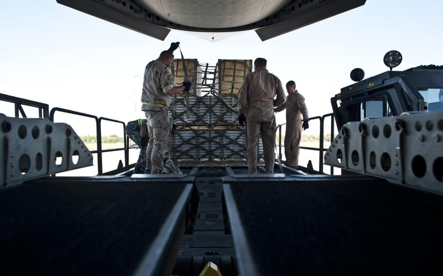 Aerial porters from the Heavy Airlift Wing at Papa Air Base, Hungary, remove pallets from a C-17 Globemaster III after a recent Swedish mission. The HAW operates three Globemaster III long-range cargo jets under the Strategic Airlift Capability program that consists of 10 NATO nations and two Partnership for Peace nations.