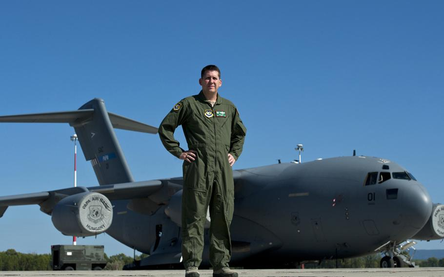 U.S. Air Force Col. Keith Boone, Heavy Airlift Wing commander, oversees the strategic airlift operations and personnel of 12 nations of the Strategic Airlift Capability Program at Papa Air Base, Hungary.