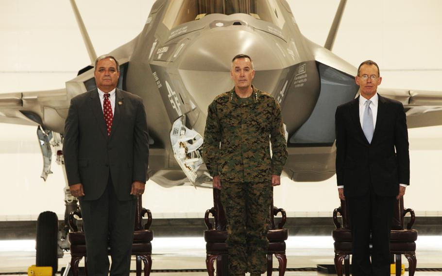 U.S. Representative Jeff Miller, Assistant Commandant of the Marine Corps Gen. Joseph F. Dunford Jr., and Lockheed Martin CEO Robert Stevens stand for the playing of the national anthem at the Marine Corps' F-35B Lightning II Rollout Ceremony at Eglin Air Force Base, Fla., Feb. 24, 2012.