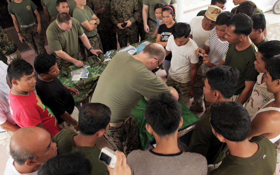 Navy Lt. Charles J. Siegert, a general surgeon, performs a live-tissue, medical demonstration for Royal Cambodian Navy medical staff in this June 2011 photo at Ream Naval Base, Kampot Province, Cambodia. The demonstration was done at the First Annual Medical Stability Symposium, and allows U.S. and Royal Cambodian Armed Forces medical personnel to exchange medical expertise.