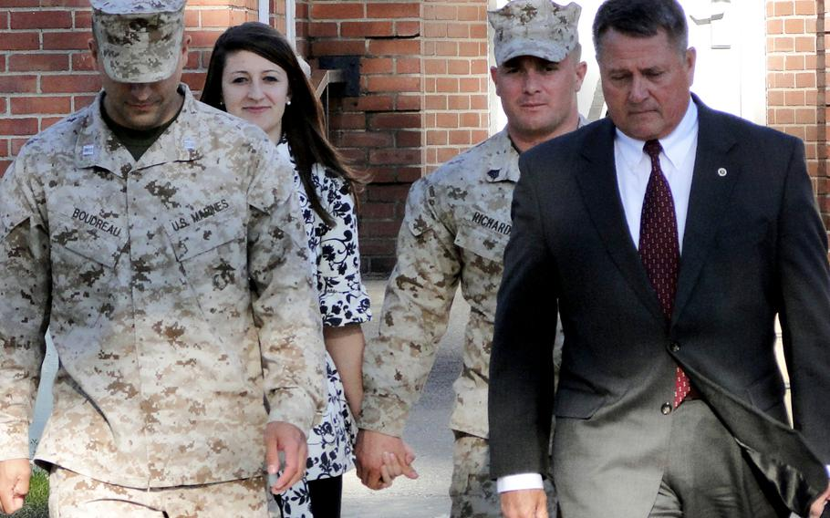 Military defense counsel Capt. Robert Boudreau, Raechel Richards, Sgt. Robert Richards and defense lawyer Guy Womack leave the courtroom at Camp Lejeune, N.C., on March 19, 2013.