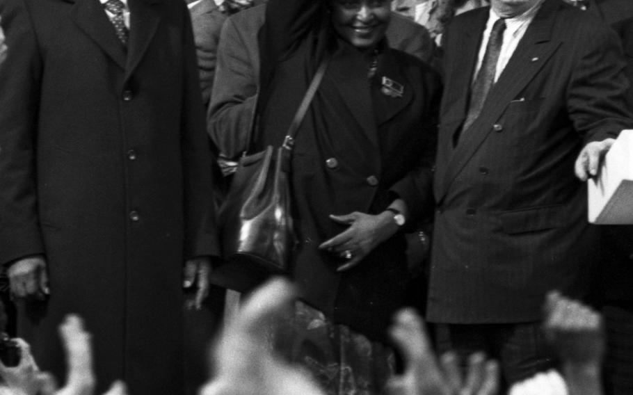 Winnie Mandela offers a salute to the crowd.