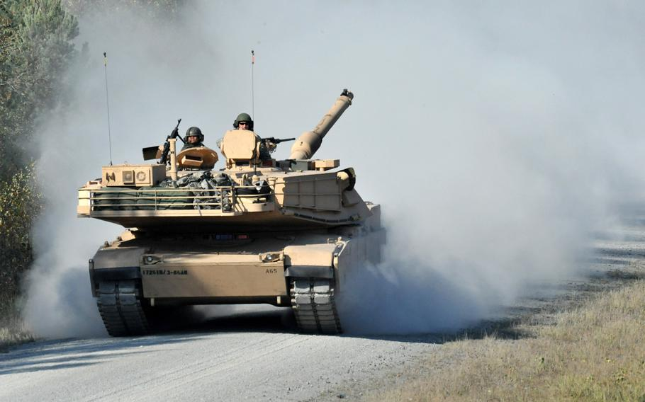 U.S. Army soldiers of Alpha Company, 3rd Battalion 66th Armor Regiment, Task Force 1-2, 172nd Infantry Brigade conduct a live fire training exercise using M1 Abrams tanks at Grafenwoehr Training Area, Germany in this Oct. 2010 photo.