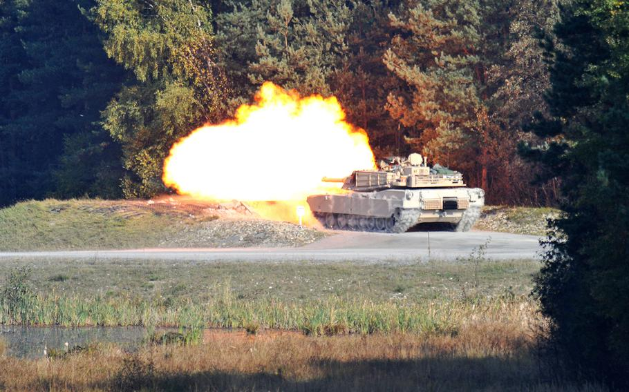 U.S. Army soldiers of Alpha Company, 3rd Battalion 66th Armor Regiment, Task Force 1-2, 172nd Infantry Brigade conduct a live fire training exercise with M1 Abrams tanks at Grafenwoehr Training Area, Germany in this Oct. 2010 photo.