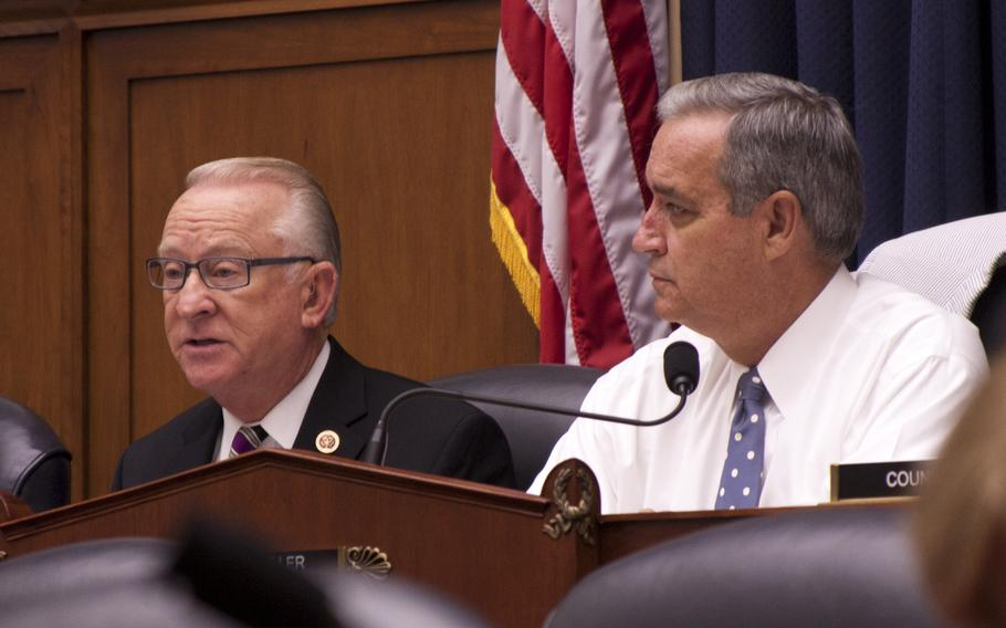 Rep. Buck McKeon, R-Calif., chairman of the House Armed Services Committee, speaks while Rep. Jeff Miller looks on at a joint Congressional hearing with the Defense Department and Department of Veterans Affairs about troops' medical records on July 10, 2013 in Washington, D.C.