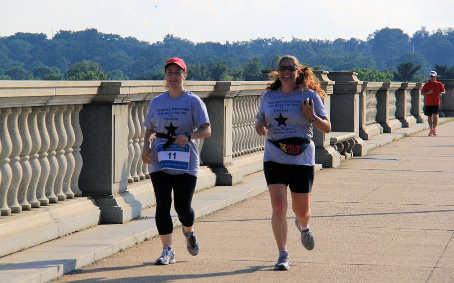 DOD civilian employee Christine Smith, right, was one of nearly 50 people who set out across the street from the Pentagon on a five mile run for furloughed defense civilians on July 8, 2013. Organizers cut the run to four miles mid-race to symbolize a 20 percent pay loss.