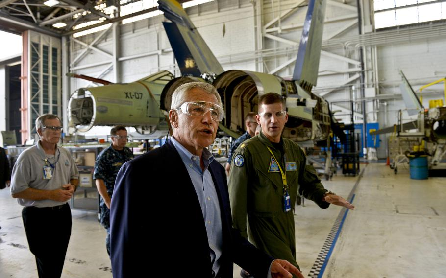 Secretary of Defense Chuck Hagel is given a tour of the Fleet Readiness Center on NAS Jacksonville, Fla., July 16, 2013.