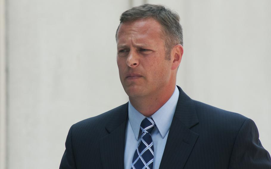 Lt. Col. Jeffrey Krusinski, formerly the Air Force's point man on sexual assault prevention programs, arrives at the Arlington County courthouse on July 18, 2013. Krusinski was originally charged with sexual battery stemming from a May incident in Arlington, Va, but is now being charged with assault and battery.