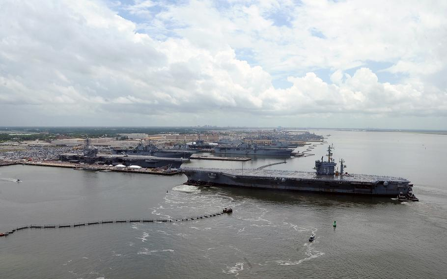 The aircraft carrier USS Dwight D. Eisenhower returns to homeport at Naval Station Norfolk on July 3, 2013.