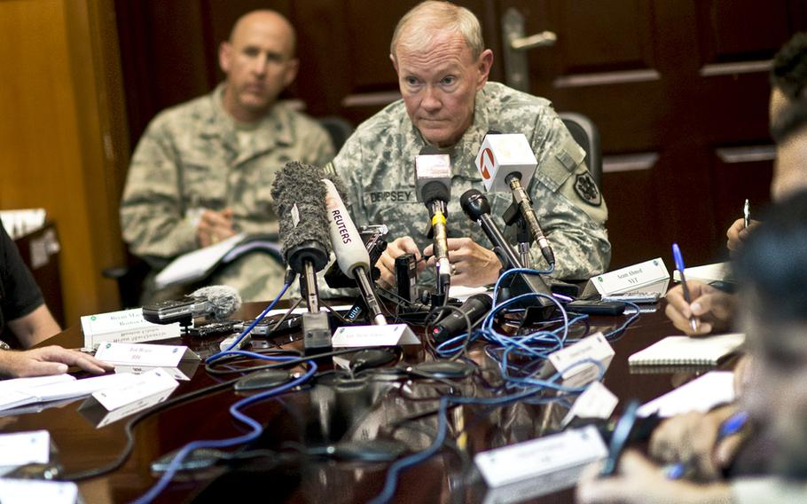 Chairman of the Joint Chiefs Gen Martin E. Dempsey conducts a press conference in Kabul, Afghanistan, Jul 22, 2013.
