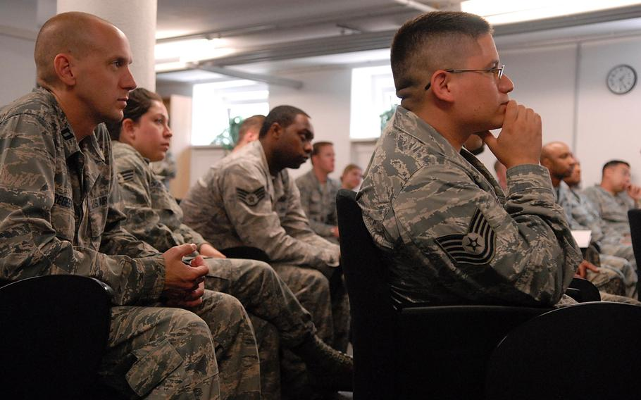 Airmen listen during a ceremony Tuesday at the Air Force Deployment Transition Center on Ramstein Air Base, Germany. The center, the only of its kind in the Defense Department, has supported more than 6,000 servicemembers since opening its doors in July of 2010.