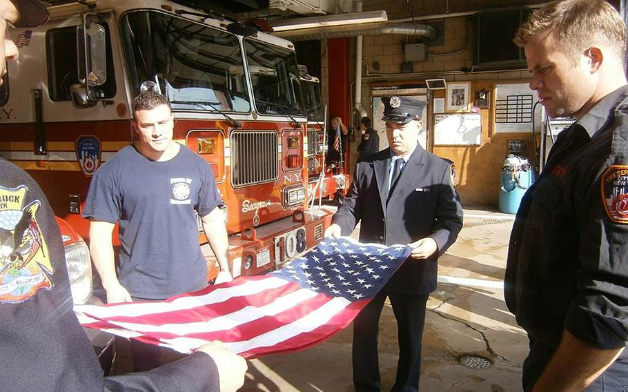 Members of the New York Fire Department, Engine Company 216, Ladder Company 108, who are also veterans, participate in a program where they have flags flown in combat or at Ground Zero in New York, and then present those flags to Gold Star families.