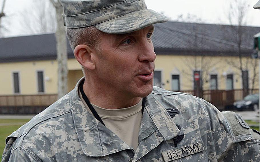 """Col. David W. Buckingham attends a ceremony at  Caserma """"C. Ederle"""" Vicenza, Italy, on March 8, 2013."""