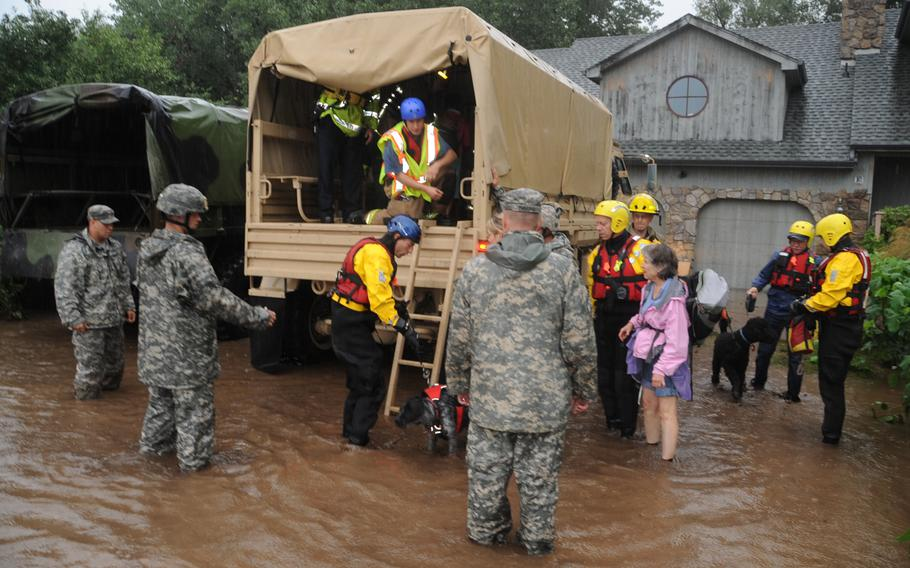 U.S. soldiers and airmen with the Colorado National Guard respond to floods in Boulder County, Colo., Sept. 12, 2013. The Colorado National Guard was activated to provide assistance to people affected by massive flooding along Colorado's Front Range.
