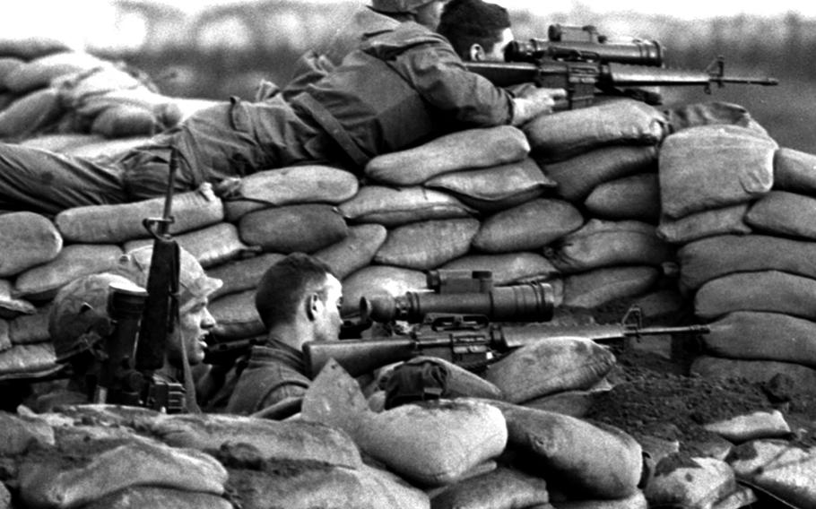 Khe Sanh, South Vietnam, March, 1968: U.S. Marines use sniperscopes to help zero in on North Vietnamese troops surrounding Khe Sanh during the 77-day battle at the remote outpost.