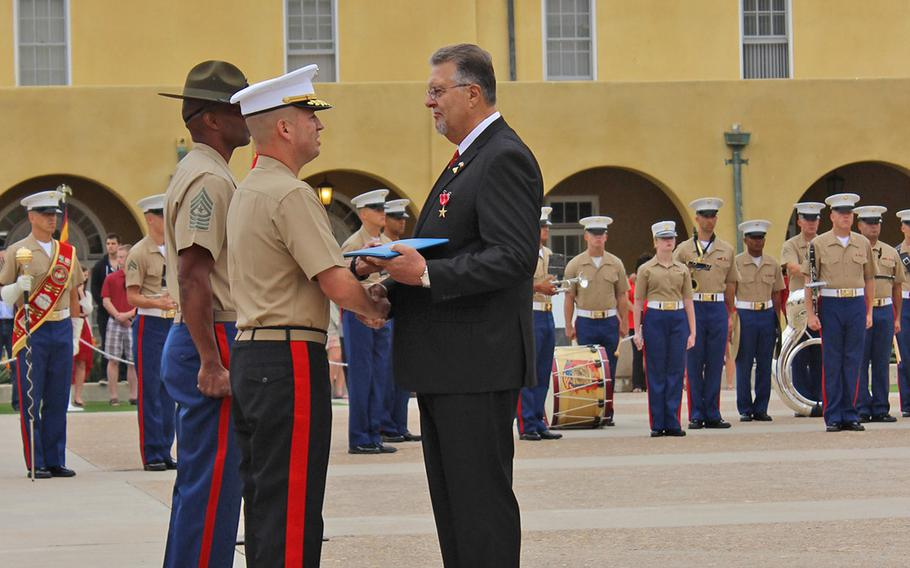Brig. Gen. James W. Bierman, commanding general of Marine Corps Recruit Depot San Diego, presents the Bronze Star with V to Robert T. Moffatt for his actions during the April 30, 1967 Battle of Khe Sanh.