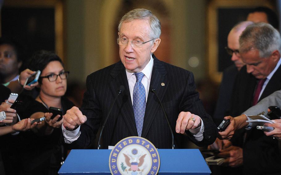 Senate Majority Leader Harry Reid speaks to reporters at the Capitol in Washington, D.C., September 10, 2013.