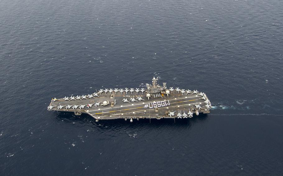 The aircraft carrier USS George Washington moves in the Philippine Sea, Sept. 29, 2013.