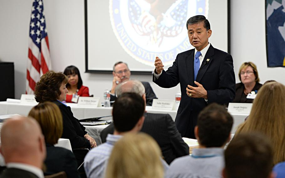 Department of Veterans Affairs Secretary Eric Shinseki visits a Texas regional office to talk to staffers about processing claims on Aug. 27, 2013.