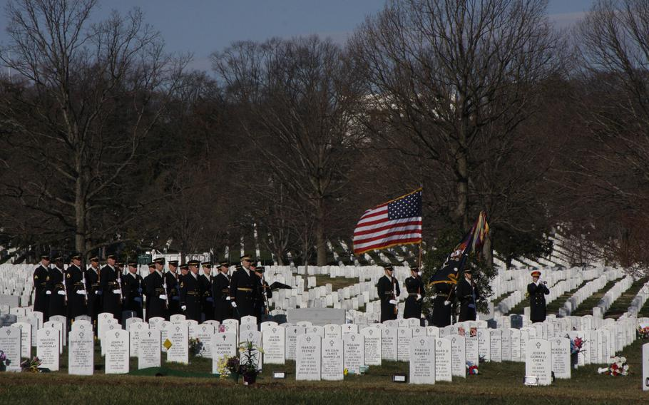 Taps is played at a funeral of a soldier killed in Afghanistan at Arlington National Cemetery on March 27, 2013.