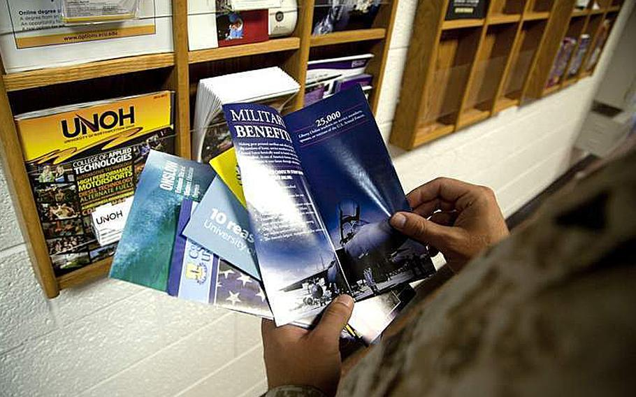 A Marine reads college pamphlets at the Education Center on Marine Corps Base Camp Lejeune, N.C., July 30, 2013.