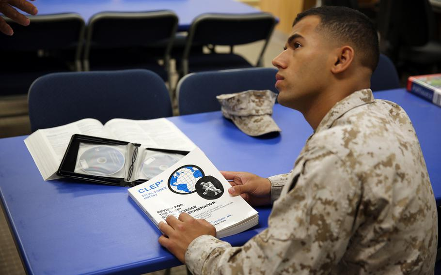 Lance Corporal Samuel Ribeiro, an adjutant clerk on Marine Corps Logistics Base Barstow, Calif., receives information about the College Level Examination Program at the base library on Sept. 9, 2013.
