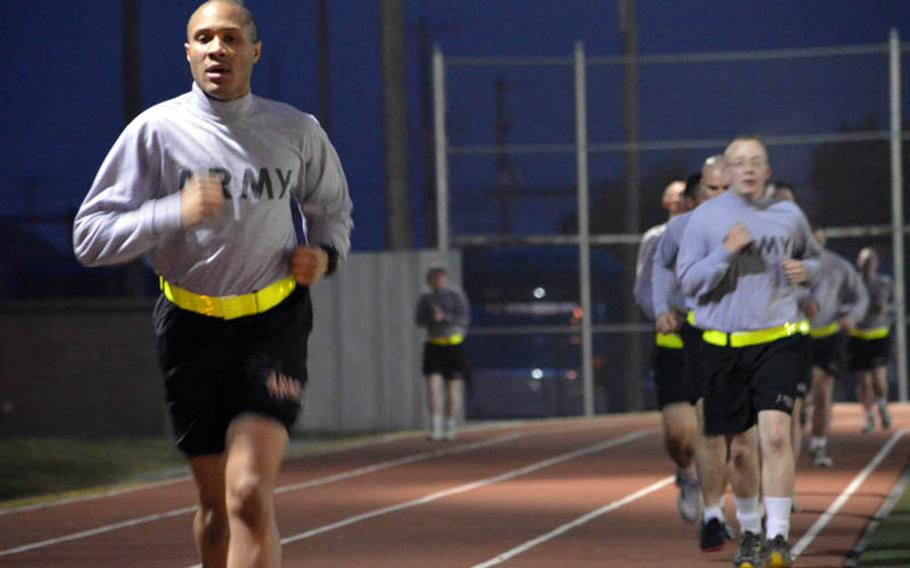 U.S. Army soldiers from the 35th Air Defense Artillery Brigade run laps around a track as part of their morning physical fitness training at Osan Air Base, South Korea, on Oct. 28, 2013. Eighth Army extended its morning APFT from 60-minute to 90-minute workouts on Oct. 21, 2013. Armando R. Limon/Stars and Stripes
