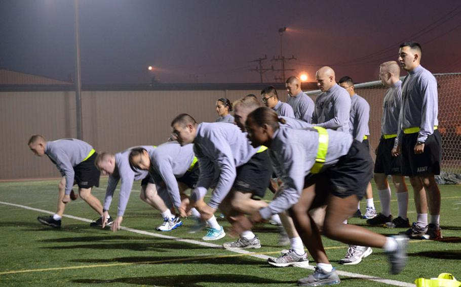 U.S. Army soldiers from the 35th Air Defense Artillery Brigade perform morning physical fitness training at Osan Air Base, South Korea, on Oct. 28, 2013. Eighth Army extended its morning APFT from 60-minute to 90-minute workouts on Oct. 21, 2013. Armando R. Limon/Stars and Stripes