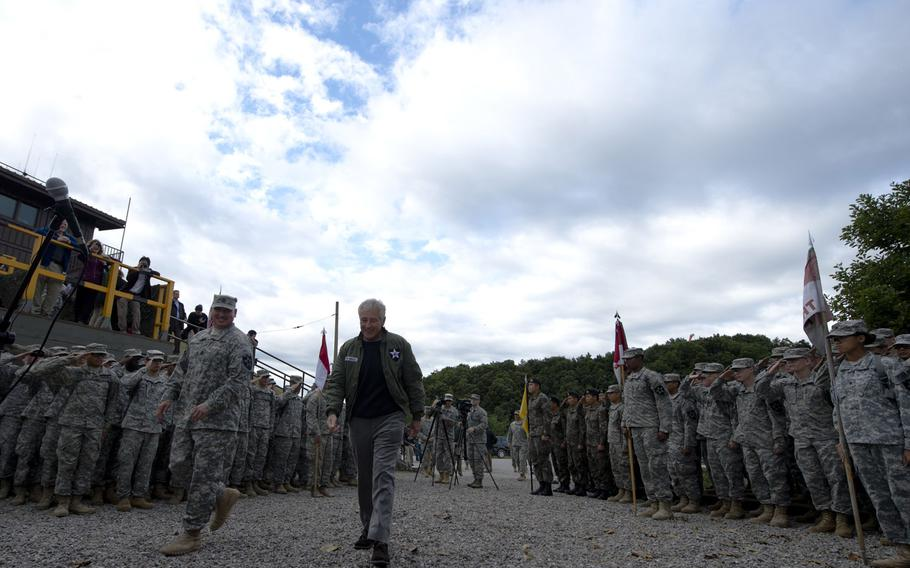 Secretary of Defense Chuck Hagel greets troops from the 2nd Infantry Division in the Republic of Korea, Sept. 30, 2013. Hagel visited with a few hundred American and Korean troops taking questions and thanking them for their service.