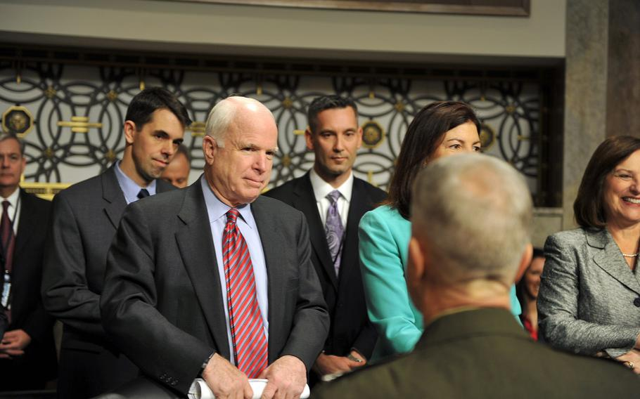 Sen. John McCain, R-Ariz., greets Marine Corps Commandant Gen. James Amos before a Senate Armed Services Committee hearing on sequestration at the Dirksen Senate Office Building in Washington, D.C., on Feb. 12, 2013.