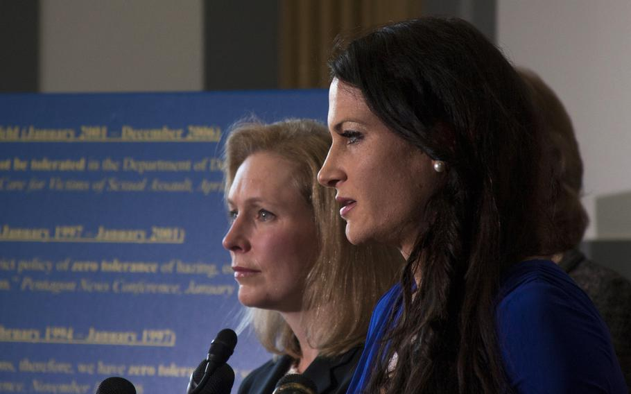 Ariana Klay, a former Marine officer and military sexual assault survivor, speaks in Washington, D.C. on Nov. 6, 2013, as Sen. Kirsten Gillibrand, D-NY, (background) looks on. Gillibrand is leading a bipartisan push calling for military sexual assault cases to be removed from the military chain of command.