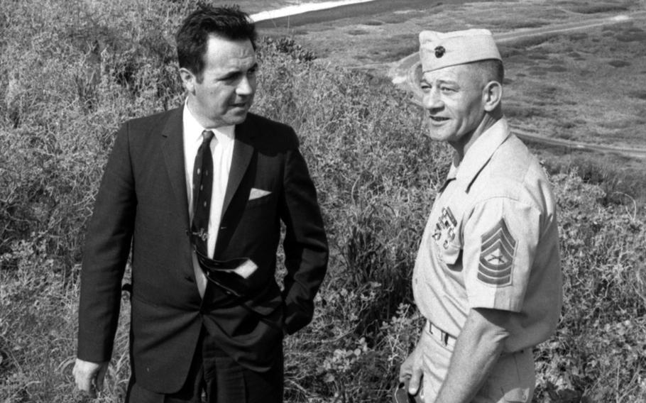Iwo Jima veterans Rene Gagnon, left, and Master Sgt. Andrew Zihar atop Mt. Suribachi in February, 1965.