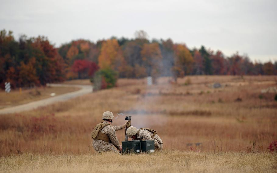 Marines use the Office of Naval Research's new Fire Control Unit 60 mm Mortar sight to accurately locate targets Tuesday during a demonstration at Marine Corps Base Quantico, Va. The FCU utilizes a mini red dot sight for day aiming and has laser capabilities for improved night fire accuracy when using the mortar in the handheld mode. ONR TechSolutions accepts recommendations and suggestions from Navy and Marine Corps personnel on ways to improve mission effectiveness through the application of new technology.