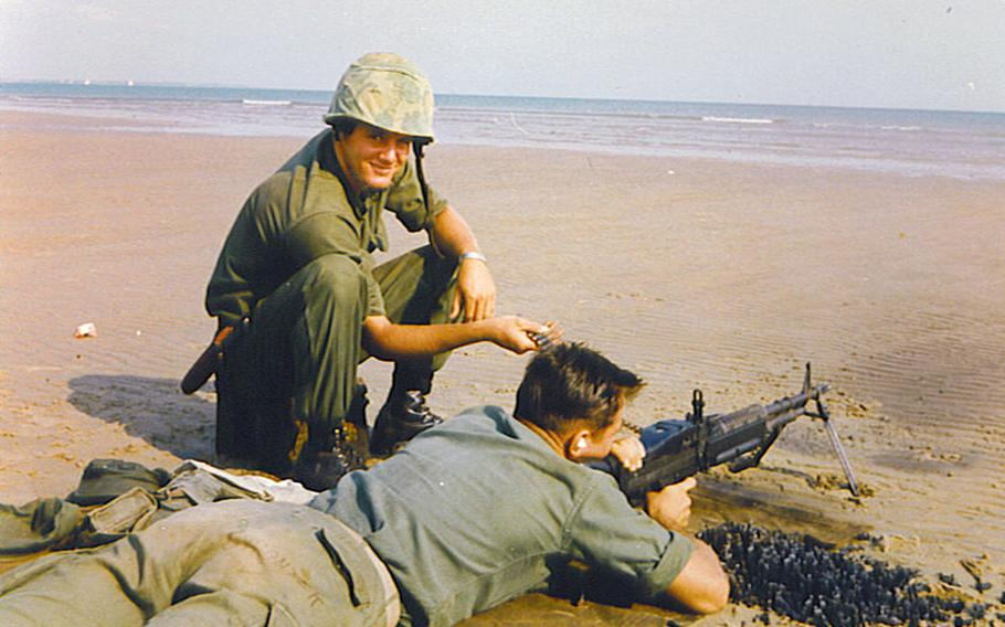 Marine Cpl. Gregory Harris, left, is seen here smiling as he feeds ammunition during training. Harris was declared missing following a 1966 ambush in Quang Ngai Province, South Vietnam.
