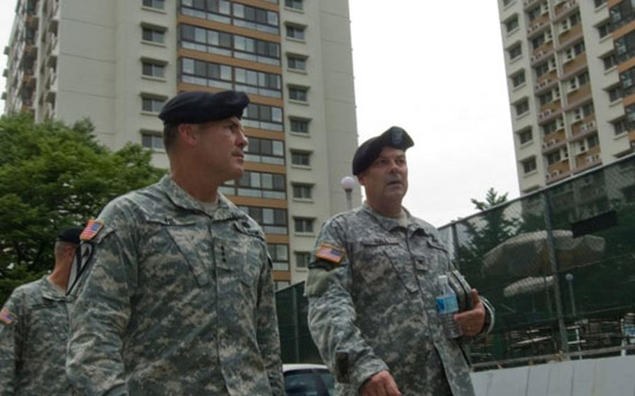 Eighth U.S. Army Commander Lt. Gen. Joseph F. Fil, Jr. (left) receives a tour of Hannam Village leased housing from USAG-Yongsan Commander Col. Dave Hall July 10. Many enlisted servicemembers and junior-grade officers reside at Hannam Village and work at nearby Yongsan Garrison in Seoul.