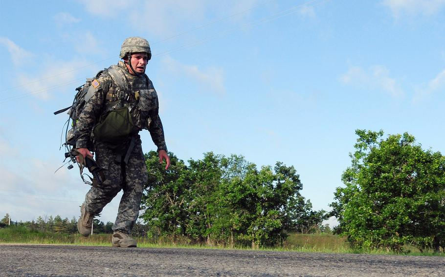 An Army Reserve soldier completes a ruck march during an Army Reserve Best Warrior Competition at Fort McCoy, Wis., on July 15, 2009.