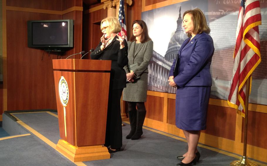 Sen. Claire McCaskill, D-Mo., speaks in November 2013 about a bipartisan amendment to strengthen and augment the package that passed the Armed Services Committee in June to curb military sexual assault. With her are Sen. Kelly Ayotte, R-N.H., and Sen. Deb Fischer, R-Neb.