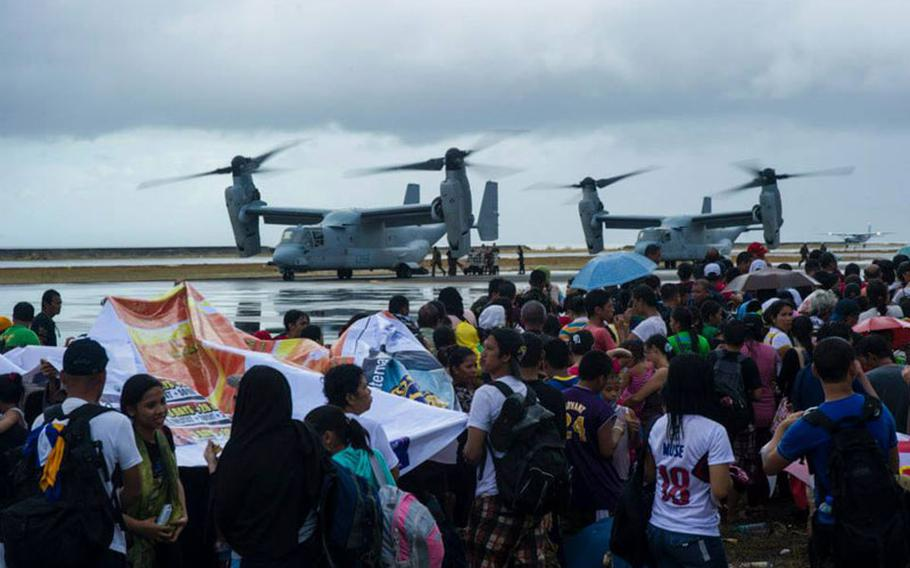 MV-22 Ospreys assigned to the Marine Medium Tiltrotor Squadron 261, 1st Marine Aircraft Wing, load supplies to provide aid during Operation Damayan.