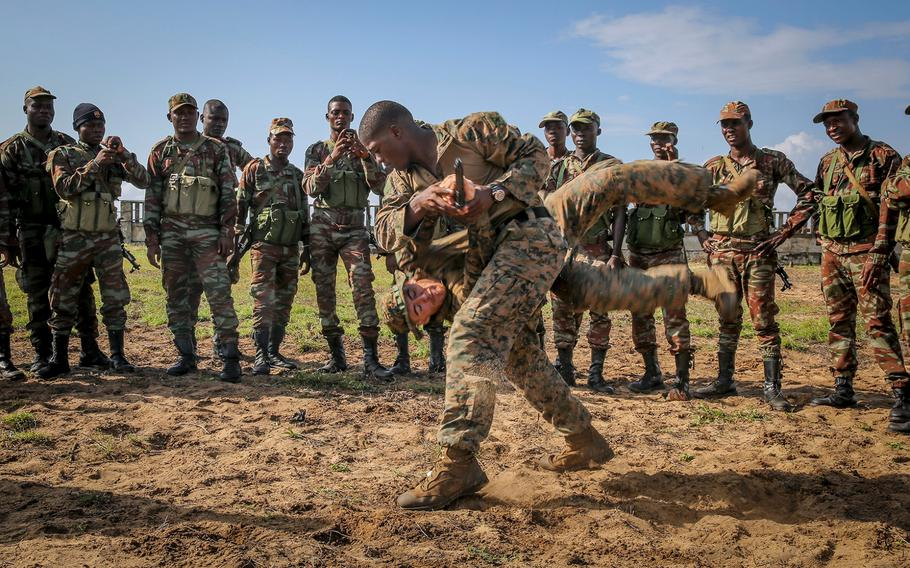 Marine Corps Martial Arts instructors demonstrate techniques during a martial arts class October 10, 2013, in Benin, Africa, where dozens of U.S. troops met with Benin Armed Forces to work on different tactical procedures in order to build on their maritime security capabilities.
