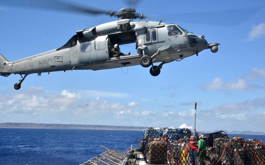 An MH-60 Seahawk approaches the USNS Charles Drew in the Philippine Sea to get more supplies in support of Operation Damayan, Nov. 15, 2013.