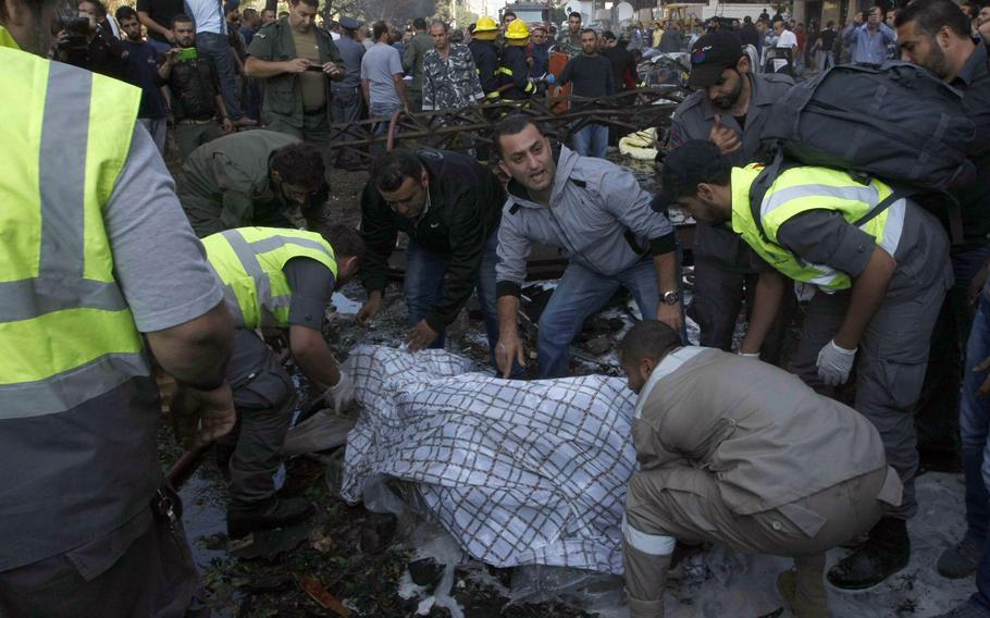 Emergency workers come to the scene as bombs outside the Iranian embassy in Beirut killed dozens and wounded scores more on Nov. 19, 2013, in what was widely seen as a retaliation for Iran and Hezbollah's support of Syrian President Bashar Assad.