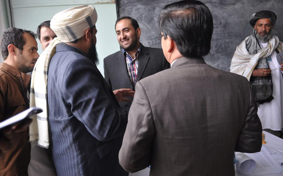 Members of the Afghan Loya Jirga discuss a security agreement that would pave the way for foreign troops to stay in Afghanistan past the end of 2014. The jirga, a gathering of 2,500 community leaders from around the country, was convened by President Hamid Karzai who has said he will respect the council's decision on the security agreement.