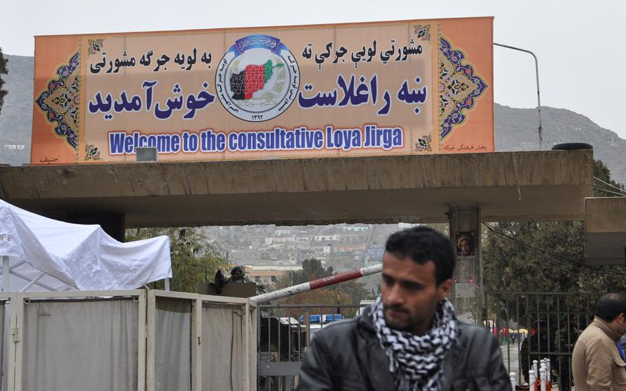 A sign outside the Afghan Loya Jirga, a gathering of 2,500 community leaders from around the country, who are debating a security agreement with the United States and that would pave the way for international troops to stay in Afghanistan past the end of 2014. The jirga was convened by President Hamid Karzai who has said he will respect the council's decision on the security agreement.