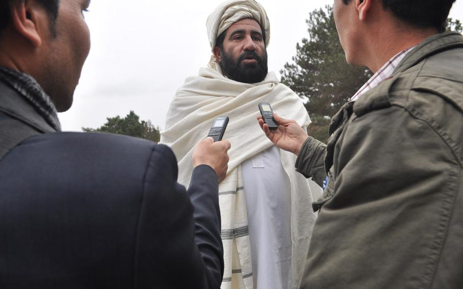 A member of the Afghan Loya Jirga is interviewed Saturday during the council's deliberation on a security agreement that would pave the way for foreign troops to stay in Afghanistan past the end of 2014. The jirga, a gathering of 2,500 community leaders from around the country, was convened by President Hamid Karzai who has said he will respect the council's decision on the security agreement.
