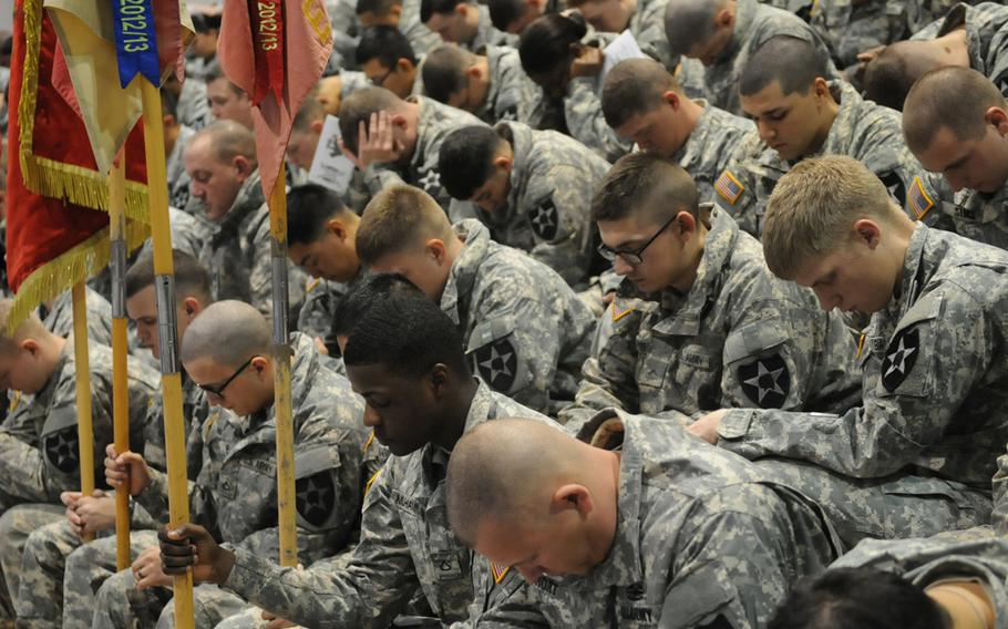 Soldiers of the 2nd Infantry Division mourn the loss of their fallen comrades Spc. Justin Adams and Maj. Evans Hanson during a Nov. 26, 2013, memorial ceremony at Camp Casey, South Korea.