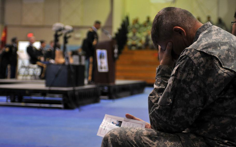 A 2nd Infantry Division soldier mourns the loss of his fallen comrades during a Nov. 26, 2013, memorial ceremony at Camp Casey, South Korea.