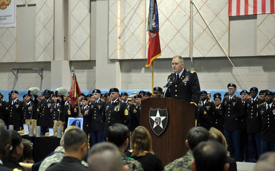 Lt. Col. Jeremy McGuire, 1st Battalion, 15th Field Artillery Regiment commander, speaks in honor of fallen soldiers Spc. Justin Adams and Maj. Evans Hanson during a Nov. 26, 2013, memorial ceremony at Camp Casey, South Korea.