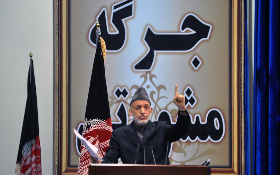Afghan President Hamid Karzai addressed the Loya Jirga, a gathering of Afghan leaders, on Nov. 24, 2013, when the group endorsed a proposed security agreement with the U.S. to keep a military training and assistance force in Afghanistan past the end of 2014.