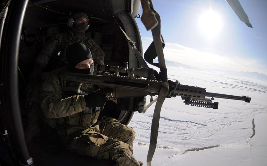 Cpl. William Hopkins looks through the scope of the Barrett .50 Cal. while Sgt. Lucas Cordes, a sniper team leader with Co. F, 282 CAB, waits for the Uh-60 Blackhawk to turn around so they can commence an aerial firing platform exercise Jan. 26.